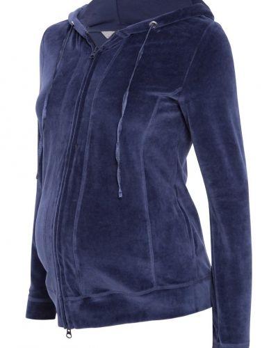 Blå zip-tröja från bellybutton till dam.