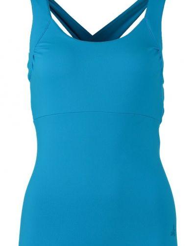 Till dam från Curare Yogawear, en turkos linnen.