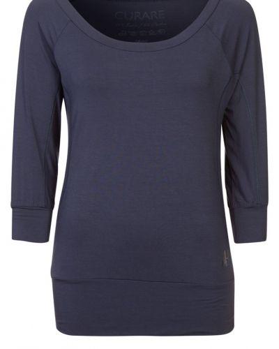 Till dam från Curare Yogawear, en blå långärmad tröja.