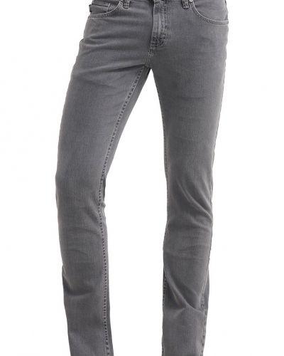 Slim fit jeans från Vans till dam.