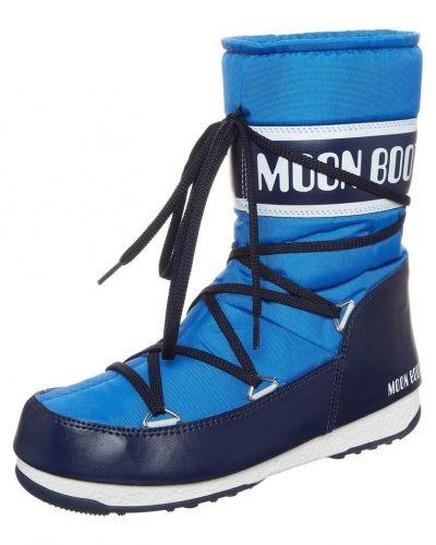 Till dam från Moon Boot, en blå känga.