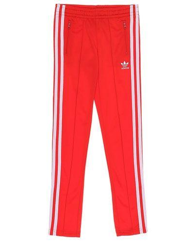 Till tjej från Adidas Originals, en röd byxa.