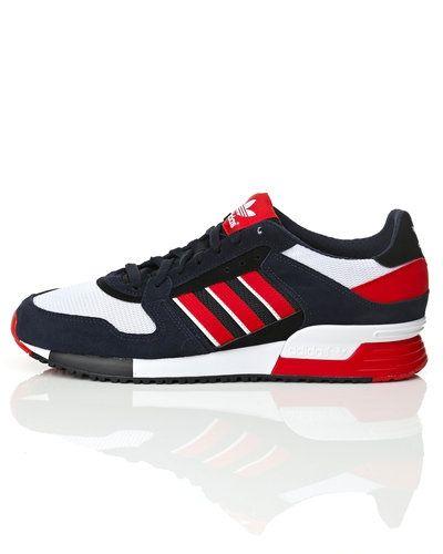 Till herr från Adidas Originals, en blå sneakers.