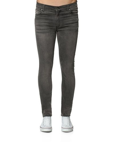 Blå slim fit jeans från Cheap Monday till unisex.