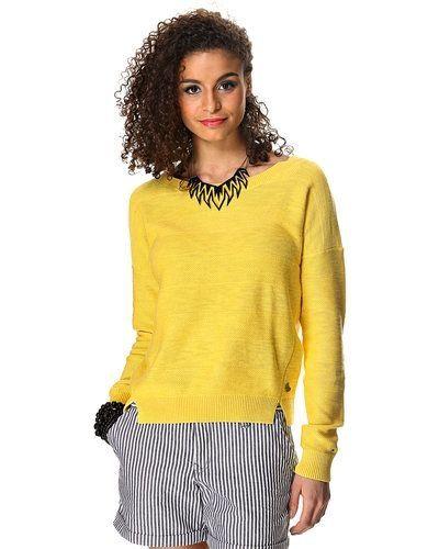 Till dam från Hilfiger Denim, en gul stickade tröja.