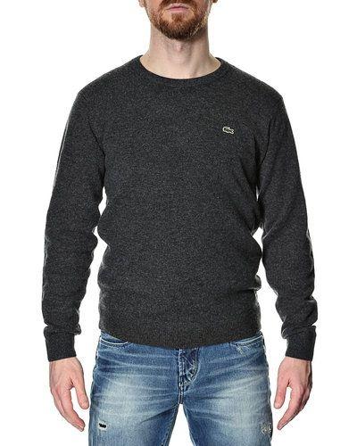 Lacoste stickad tröja Lacoste mössa till herr.