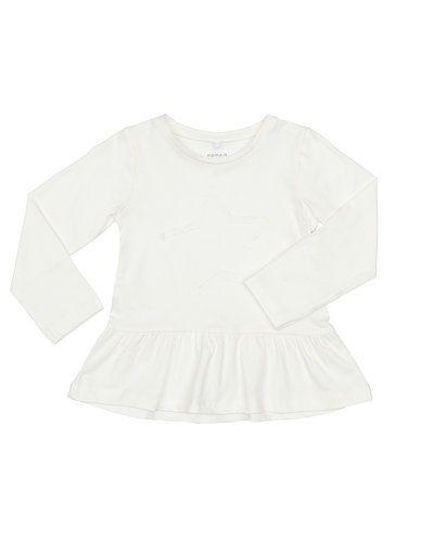 Till tjej från Name it, en vit tunika.