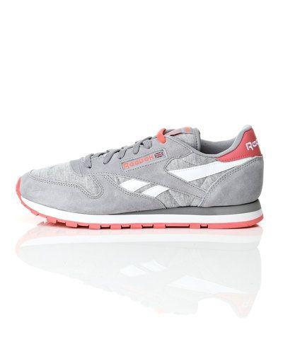 Till dam från Reebok, en grå sneakers.