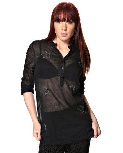 Till dam från Saint Tropez, en svart stickade tröja.