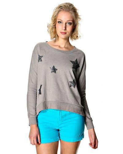 Till dam från Saint Tropez, en grå sweatshirts.