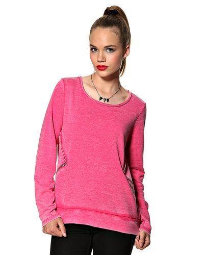 Till dam från Saint Tropez, en rosa sweatshirts.