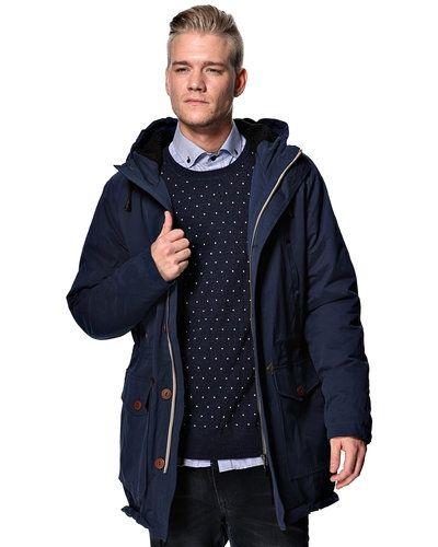 Blå höst- och vinterjacka från Suit till herr.