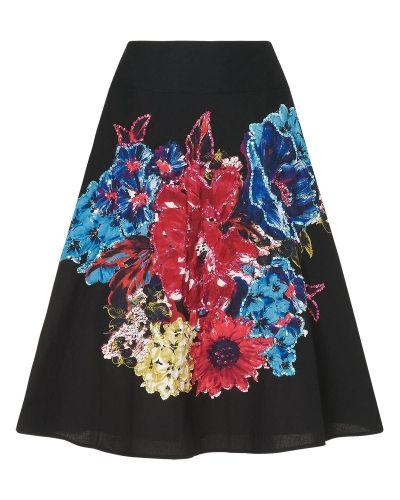Till kvinna från Phase Eight, en svart kjol.