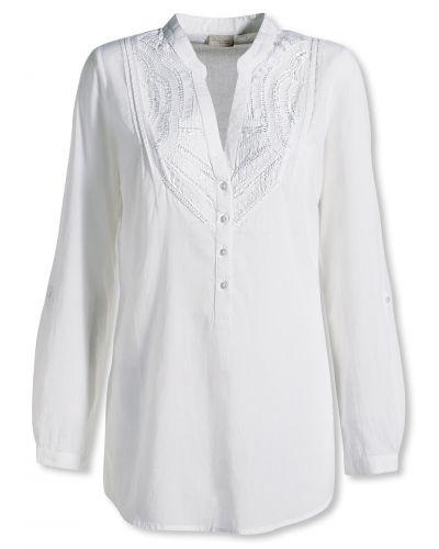 Till dam från Bonaparte, en vit blus.