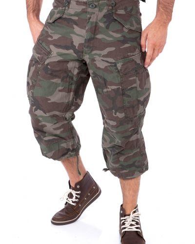 Till herr från Engineer, en metallicfärgad shorts.