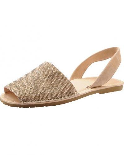 Till dam från Bianco, en guld sandal.
