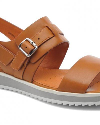Till dam från Geox, en orange sandal.