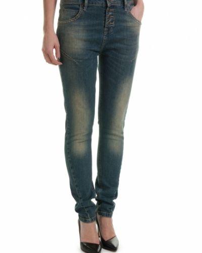Till dam från Saint Tropez, en blå blandade jeans.