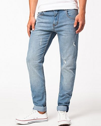 Till herr från Sweet, en blå slim fit jeans.