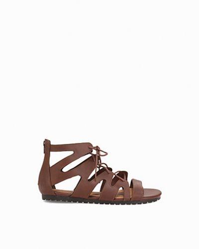 Till dam från Duffy, en brun sandal.