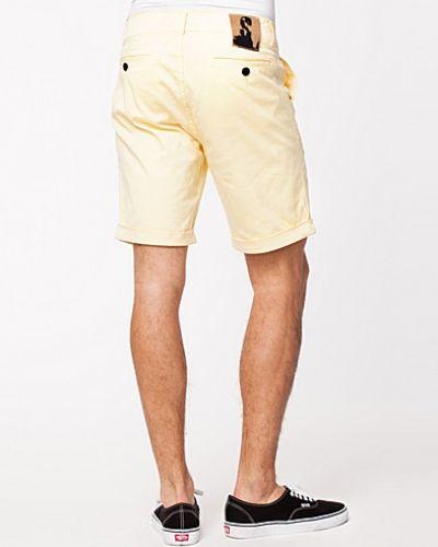 Till herr från Velour, en metallicfärgad shorts.