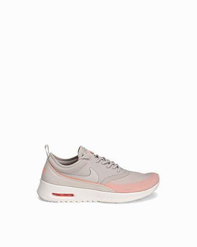 Grå sneakers från Nike till dam.