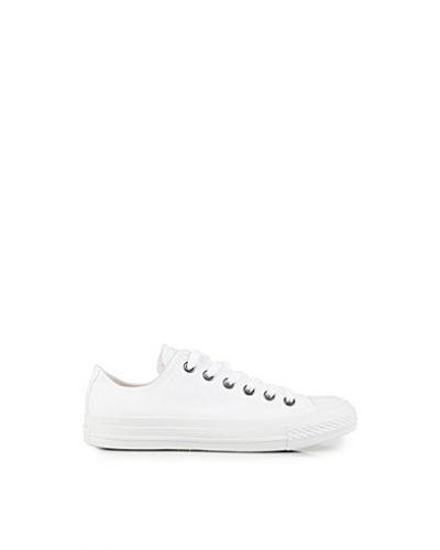 Till dam från Converse, en vit sneakers.