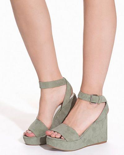 Till dam från Nly Shoes, en grön sandal.