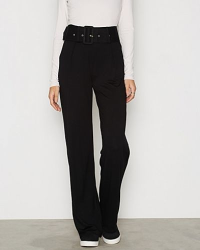 Belted Flare Pants NLY Trend byxa till dam.