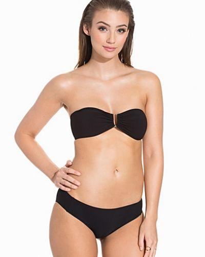 Till tjejer från Filippa K, en svart bikini.