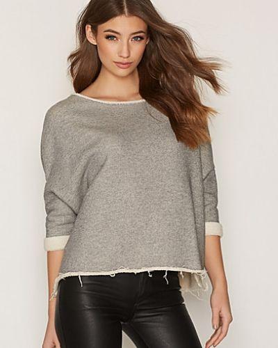 Till dam från American Vintage, en stickade tröja.