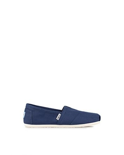 Canvas TOMS sneakers till dam.