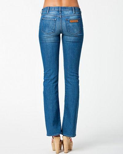 Metallicfärgad bootcut jeans från Wrangler till tjejer.