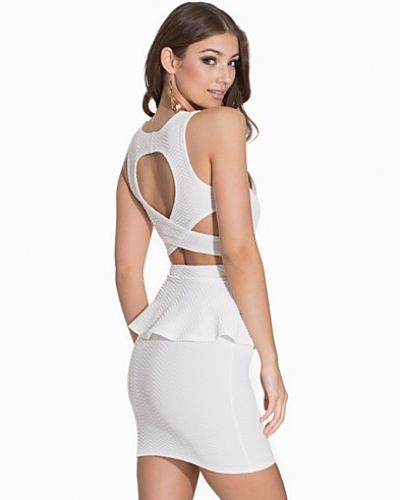Cross Back Peplum Dress NLY One fodralklänning till dam.