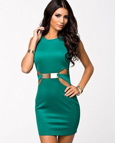 Till dam från Oneness, en grön fodralklänning.