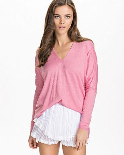 Till dam från NLY Design, en rosa stickade tröja.