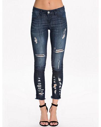 Blå slim fit jeans från Notion 1.3 till dam.