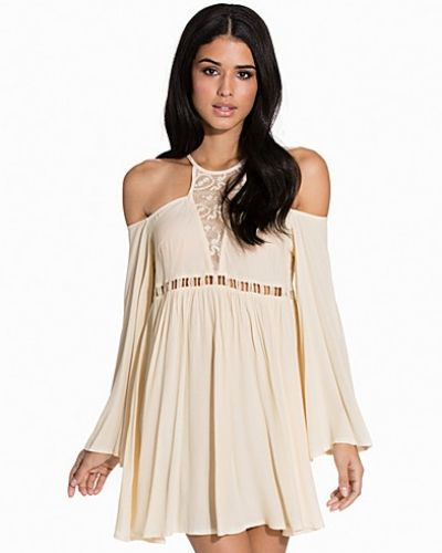 Till dam från Kiss The Sky, en creamfärgad klänning.