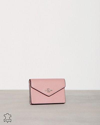 Till dam från Coach, en rosa korthållare.