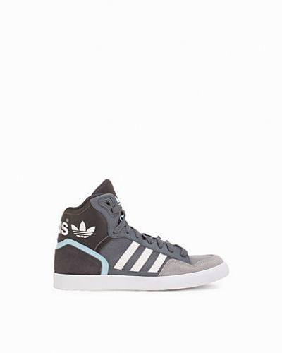 Till dam från Adidas Originals, en grå sneakers.