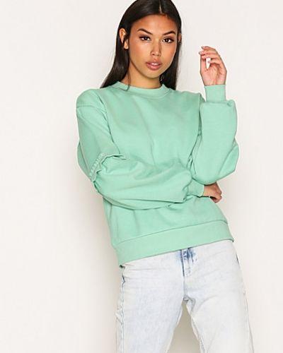 Till dam från Topshop, en grön sweatshirts.