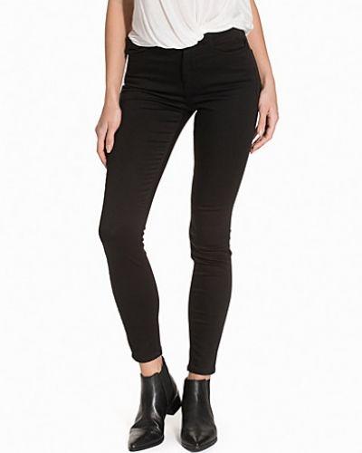 Svart slim fit jeans från Calvin Klein Jeans till dam.
