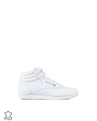 Vit sneakers från Reebok till dam.
