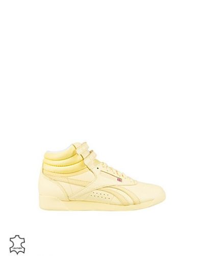 Gul sneakers från Reebok Classics till dam.