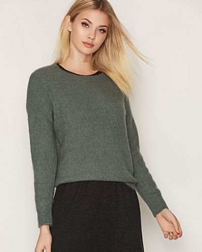 Till dam från Moss Copenhagen, en grön stickade tröja.