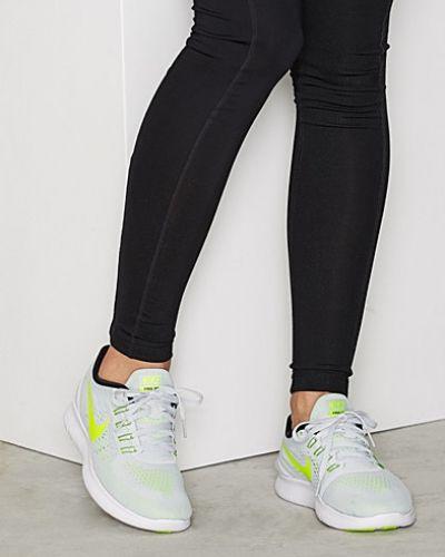Till dam från Nike, en silver löparsko.