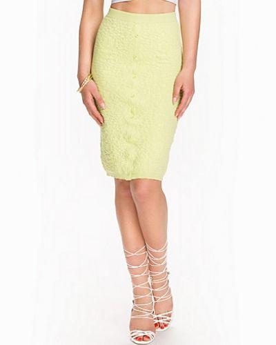Till kvinna från Miss Selfridge, en grön pennkjol.