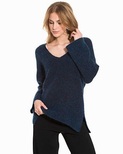 Till dam från By Malene Birger, en blå stickade tröja.