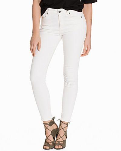 Vit slim fit jeans från J Lindeberg till dam.