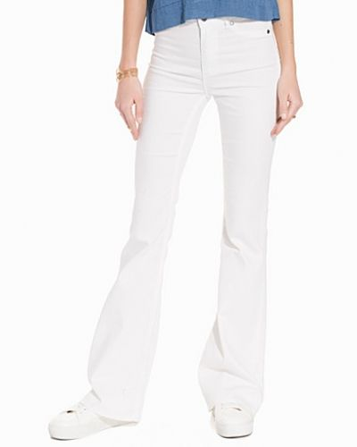 High Flare Spray White Cheap Monday bootcut jeans till tjejer.